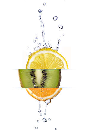 fallin: mix from lemon, orange and kiwi with fresh water drops isolated on white