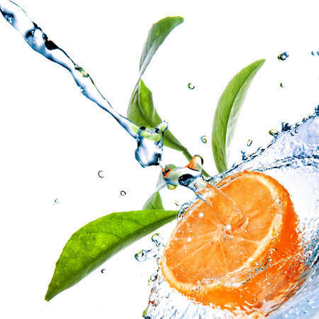 fallin: water drops on orange with green leaves isolated on white