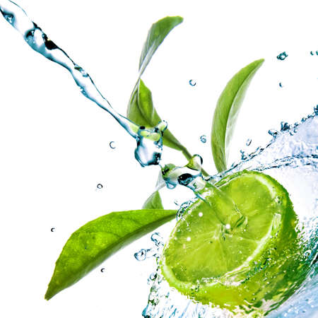 lime: water drops on lime with green leaves isolated on white
