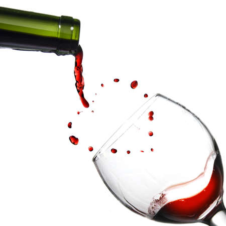 Heart fron pouring red wine in goblet isolated on white photo