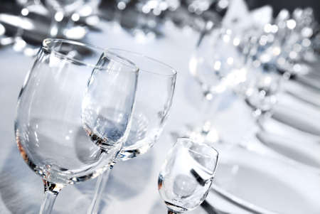 place mat: Glass goblets on white table