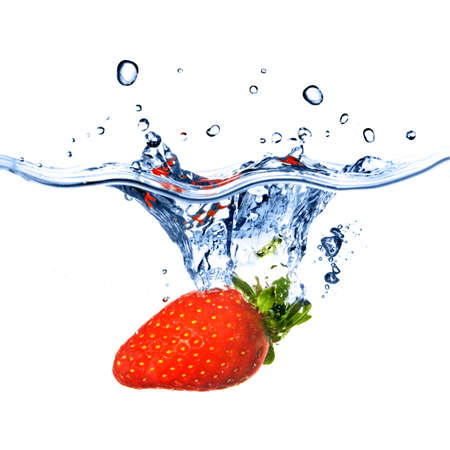 Fresh strawberry dropped into blue water with splash isolated on white Stock Photo