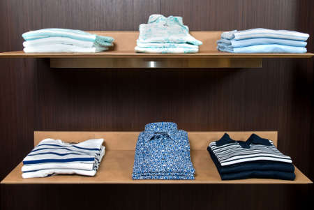 wooden store shelf with color clothes Stock Photo - 4609496