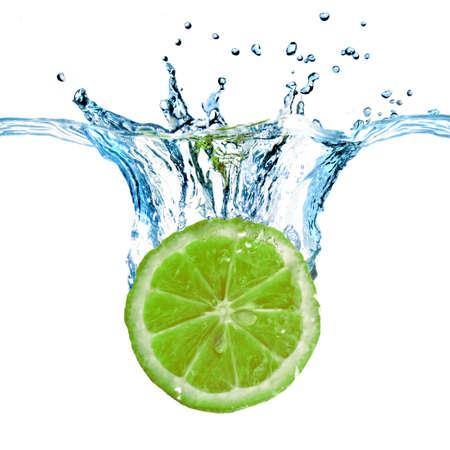 fresh taste: Fresh lemon dropped into water with splash isolated on white