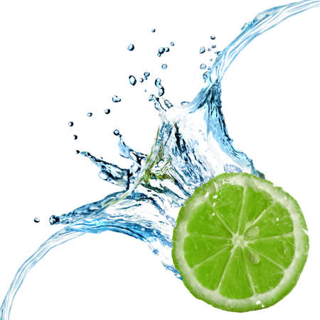 lime fruit: Fresh lime dropped into water with splash isolated on white