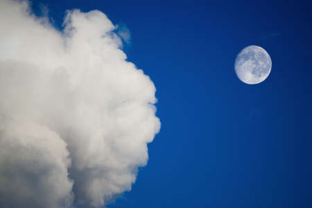 moon and clouds on the blue sky photo
