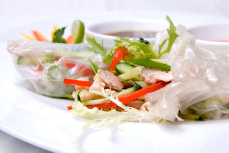 furl: chinese rolls with vegetables on the plate