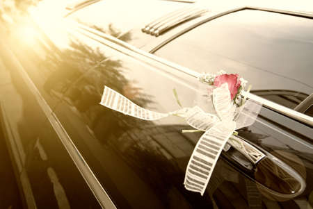 Door of black wedding car with flower and  ribbon Stock Photo - 5816385