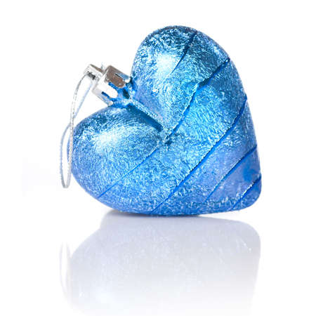 blue christmas ball in shape of heart isolated on white photo