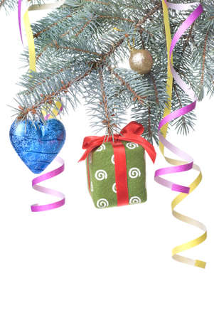 Christmas ball, gift and decoration on fir tree branch isolated on white photo