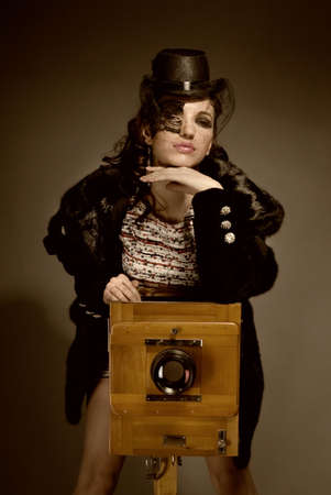 Old-style portrait of lady with vitage camera photo