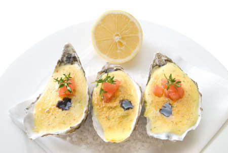 oysters with sauce and lemon photo