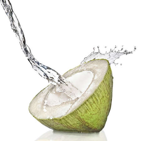 with coconut: �fresh cut green coconut on white splashing