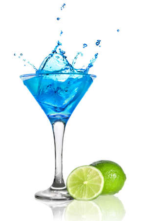 Blue curacao cocktail with splash and green lime isolated on white Stock Photo
