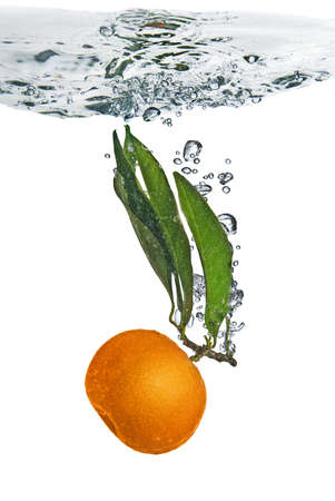 Splash of orange to water with bubbles of air  photo