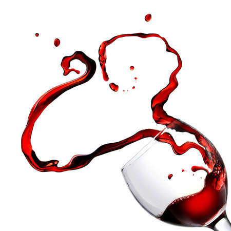 Heart from pouring red wine in goblet isolated on white photo