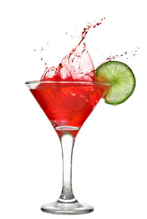 Red cocktail with splash and lime isolated on white 免版税图像
