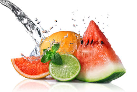 Water splash on  fresh fruits isolated on white Stock Photo