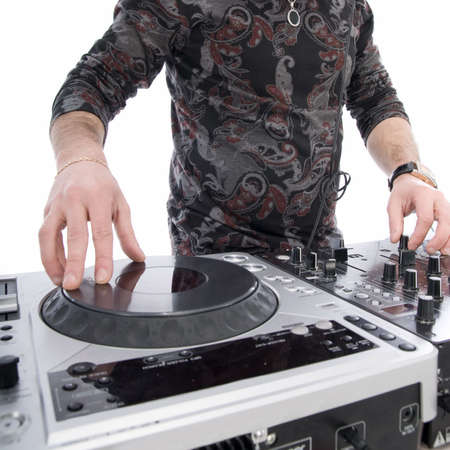 dj playing on dj mixer with isolated on white photo