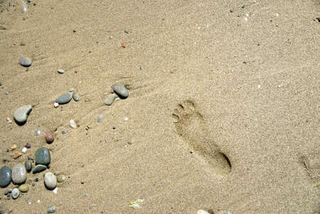 sand stones with footprint photo