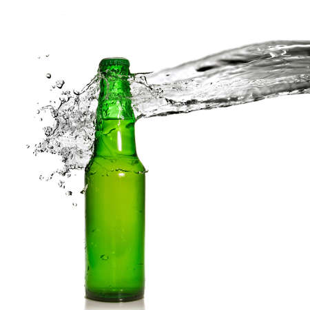 Green beer bottle with water splash isolated on white photo