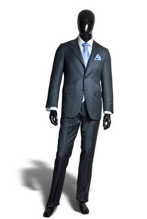 manikin: suite gris oscuro de negocio en maniqu� aislado en blanco Foto de archivo