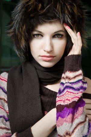 winter portrait of young woman in fur hat photo