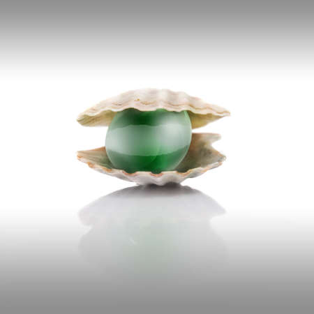 stylized green pearl on white photo