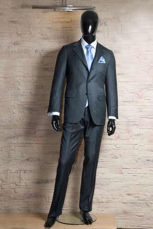 business dark grey suite on mannequin  photo