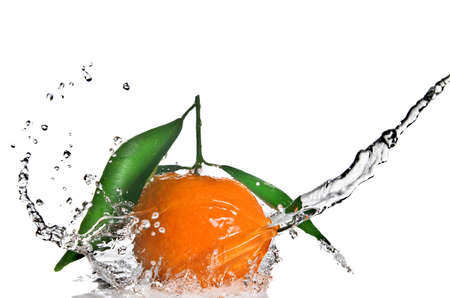 Tangerine with green leaves and water splash isolated on white photo
