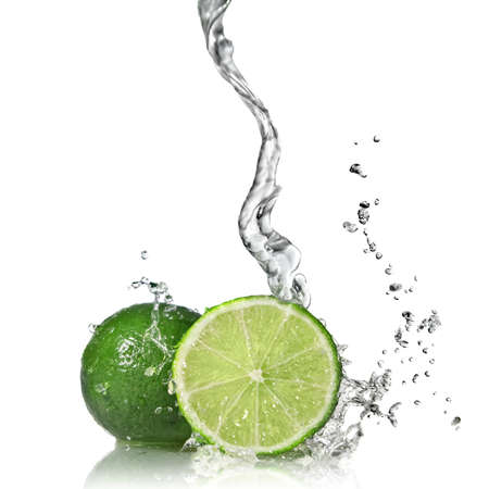 lime green: Water splash on lime isolated on white Stock Photo