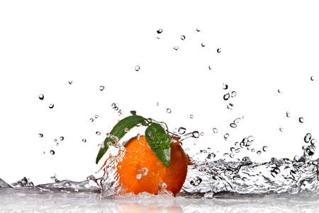 Tangerine with water splash isolated on white photo