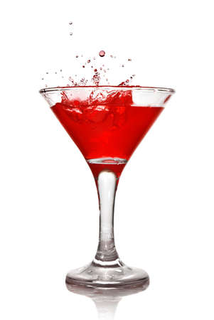 Martini cocktail with splash isolated on white photo