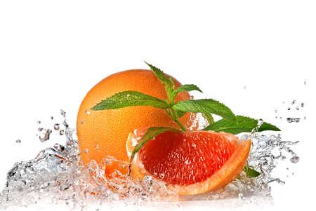 grapefruit: Water splash on grapefruit with mint isolated on white
