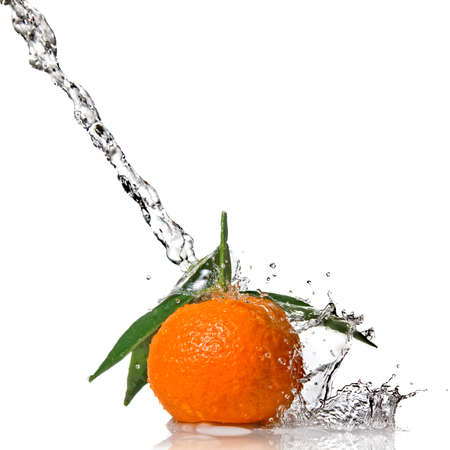 Tangerine with water splash isolated on white photo