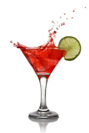 Red cocktail with splash and lime isolated on white photo