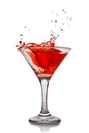 Red cocktail with splash isolated on white photo