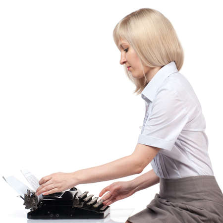 Business woman with vintage typing machine on white photo