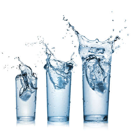 falling water: water splash in glasses isolated on white
