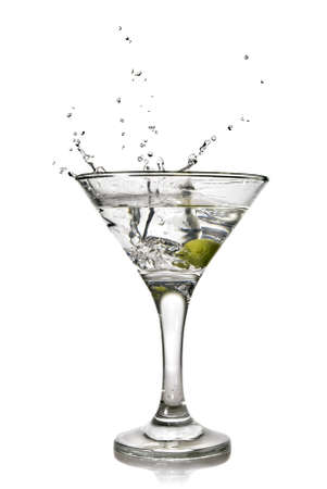martini with olive and splash isolated on white