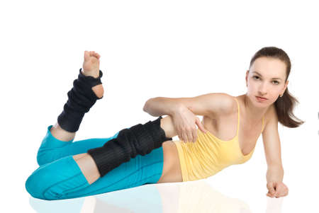 attractive woman doing gymnastics on white background Stock Photo - 7862940