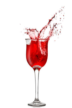 splash of red wine in goblet isolated on white photo