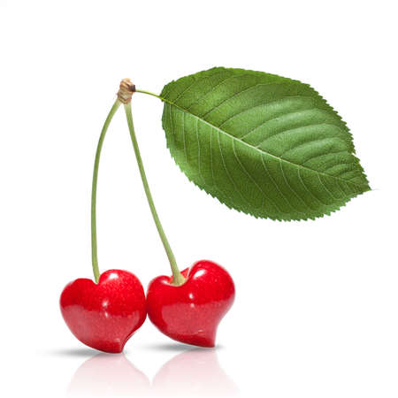 red cherry in shape of heart with leaf isolated on white photo