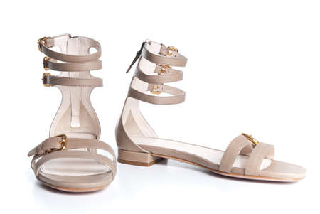 sandals isolated: beige leather female sandals isolated on white