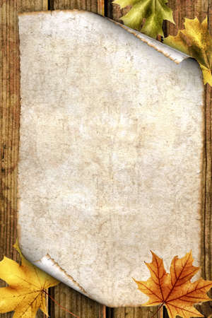 burnt wood: old paper with autumn leaves on wood Stock Photo