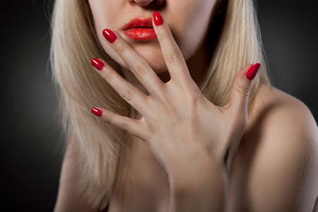 woman with red nails photo