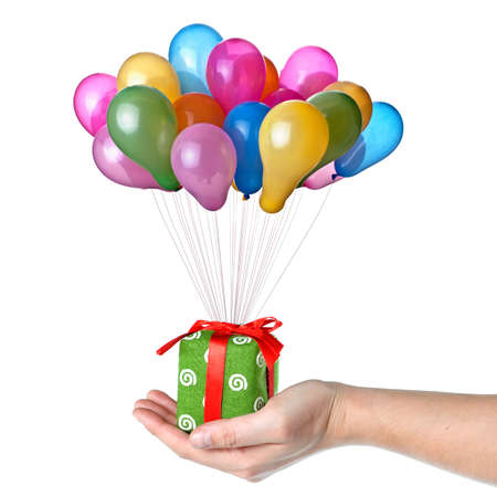 Hand holding gift with color balloons isolated on white photo
