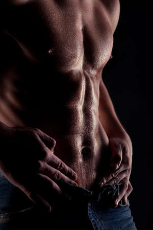 Sexy muscular naked man with water drops on stomach Stock Photo - 8825452
