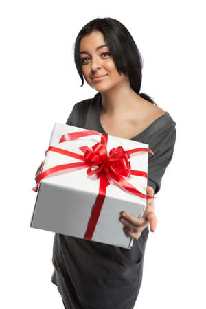 Young smiling woman holding gift isolated on white photo