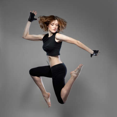 attractive jumping woman dancer photo